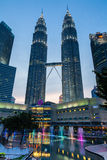 Modern sculpture in KLCC Park and Petronas Twin Towers, Kuala Lumpur Royalty Free Stock Images
