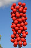 Modern Sculpture by Tilikum Crossing in Portland, Oregon. This is a modern sculpture of red balls on a metal post near Tilikum Crossing in Portland, Oregon with Stock Image