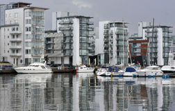 Modern Sea Side Apartments. Modern apartments by the sea with modern boats and classy style stock photo
