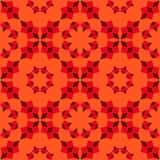 Modern seamless pattern of red shades geometrical objects on orange background Royalty Free Stock Images