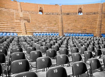 Modern seats in ancient amphitheater Stock Photography