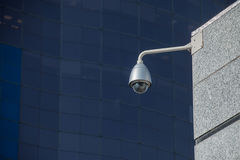 Modern security camera over office building Royalty Free Stock Image