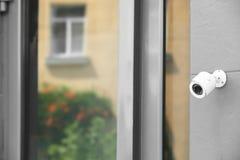 Modern security CCTV camera. On wall outdoors stock photos