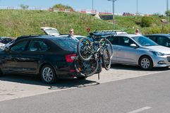 Modern sedan car transporting two mountain bycicles royalty free stock photo
