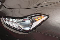 Modern sedan front headlamp Royalty Free Stock Photography