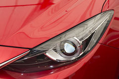 Modern sedan front lamp Stock Photography