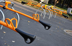 Modern seesaw in the park. Orange seesaw in the park, closeup look Royalty Free Stock Photography