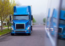 Modern semi truck blue shiny color of professional big rig Stock Images