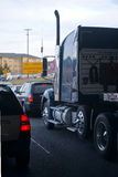 Modern semi truck on busy road with others cars Royalty Free Stock Images