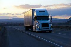 Free Modern Semi Truck Trailer On Twilight Highway Stock Photo - 76227660