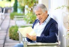 Modern senior man websurfing on tablet Stock Photography