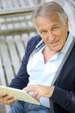 Modern senior man websurfing Stock Photo
