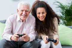 Modern senior playing on console Royalty Free Stock Photo