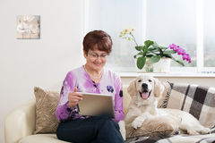 Modern senior woman with dog Stock Image