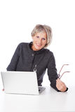 Modern senior woman using a laptop computer Stock Photos