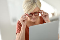 Modern senior woman working on laptop Stock Photography