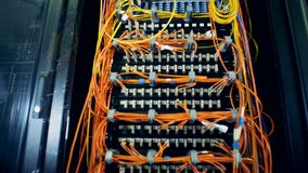 Modern server equipment. A rack with server equipment in a data-center. A rack with server equipment in a special room stock footage