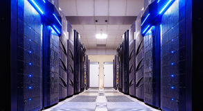 Modern server room symmetry ranks supercomputers light Stock Images
