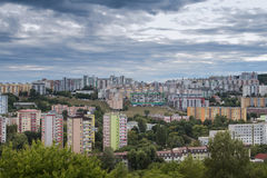 Modern Settlement and Nature. High concentration of the buildings in the modern settlement in Bratislava, Slovakia. Heavy cloudy rainy sky Stock Photo
