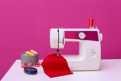 Modern sewing machine on table. Against color background royalty free stock photos
