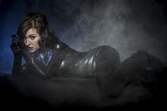 Modern, brunette in black latex costume, Fashion shot of a Royalty Free Stock Image