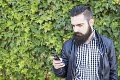 Modern and sexy man with beard take a photo. Royalty Free Stock Photo