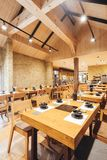 Modern Shabu and Sukiyaki Restaurant decorated with wood and concrete, warm, cozy and feels like home for special family meal.  stock image