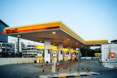 Modern Shell gas station with cars and customers Athens. Athens, Greece - Mar 28, 2016: Empty Modern Shell gas station illuminated at dusk in on of the royalty free stock image