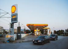 Modern Shell gas station with cars and customers Athens. Athens, Greece - Mar 28, 2016: Modern Shell gas station with cars and customers illuminated at dusk in royalty free stock image