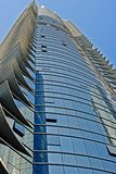 Glass facade of high rise building. Modern shiny blue glass facade of high rise building Stock Image
