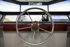 Modern ship control panel with steering wheel Stock Photos