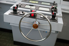 Modern ship control panel with steering wheel Stock Image