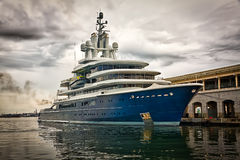 Modern ship docked with a dramatic stormy sky Royalty Free Stock Photography