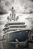 Modern ship docked with a dramatic stormy sky Royalty Free Stock Photo