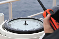 Modern ship's compass and VHF Stock Image