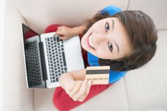 Modern shopping. The above-view of a cute teen paying for her online purchases by credit card Stock Images