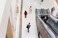 Modern shopping hall with escalator Royalty Free Stock Photography