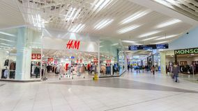 Modern shopping mall guests walk and make purchases timelapse