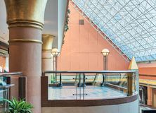 Modern shopping mall interior with glass balustrade and glass ceiling Stock Images