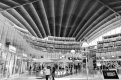 Modern shopping mall in Paris, France. The giant mussel-like concrete roof arches over the atrium of a futuristic shopping mall in Paris, France near La Defense Stock Photo