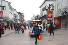 Modern and trendy shopping street in the city of Suzhou, China. Modern shopping street with shops and shopping malls in the city of Suzhou, province Jiangsu Royalty Free Stock Images