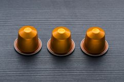 Modern Shot of Espresso Capsules on dark wood Stock Photos