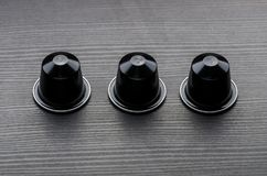 Modern Shot of Espresso Capsules on dark wood Royalty Free Stock Image