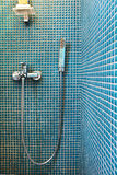 Modern Shower. Shower with blue mosaic wall royalty free stock photography