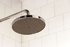 Modern shower on the background of tiles in the bathroom close-up royalty free stock photography