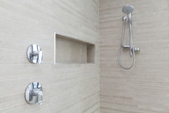 Modern shower in bathroom. Modern shower and taps in bathroom Royalty Free Stock Photo