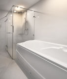 Modern shower and bathtubs. Royalty Free Stock Photo