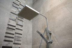 Modern shower head. A large modern luxurious shower head stock photo