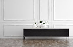 Modern side table in a classic panelled room. Modern black side table in a classic white wood panelled room with natural hardwood floor with three contemporary Stock Image