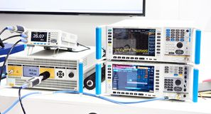 Modern electronic measuring devices. Modern signal generator, spectrum analyzer devices in exhibition stock image